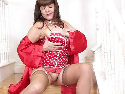 Dressed in red lingerie and inured nylon stockings busty Rebecca Love goes solo
