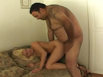 Mature blonde Kinzy Jo fucks a fat landlord for a charter
