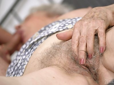 Senile granny close to big pair Norma B gets intimate close to young man