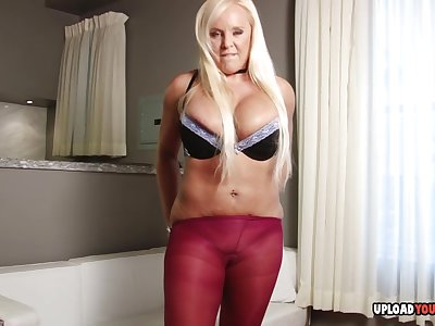 Stepmom puts on pantyhose with an increment of masturbates passionately